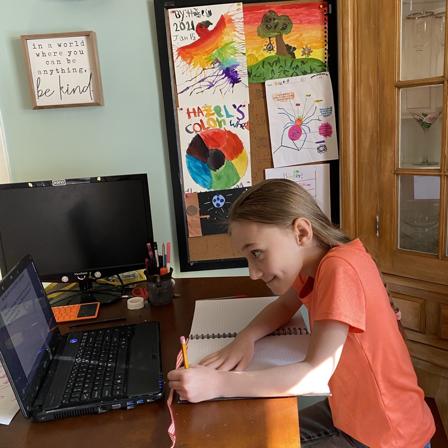 Young child sitting at computer learning
