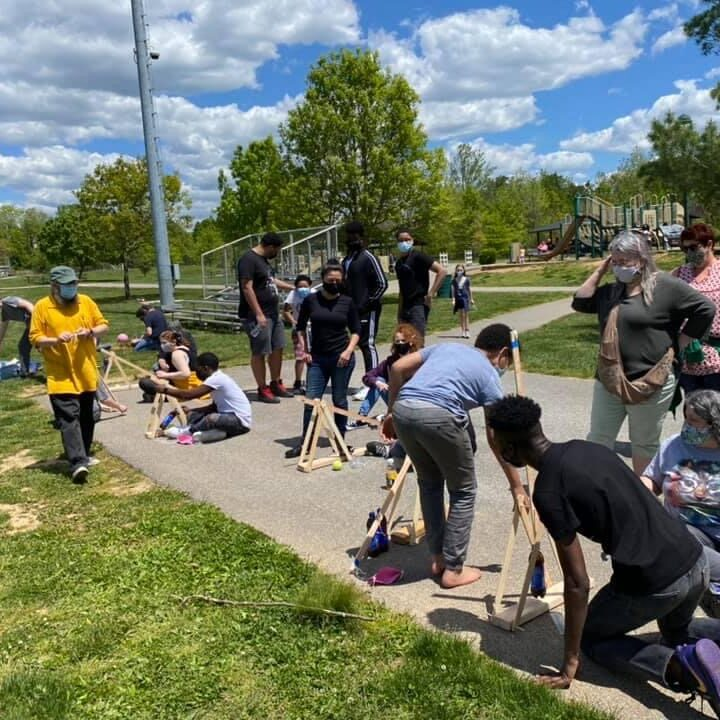 Kids outside for science class learning about catapults
