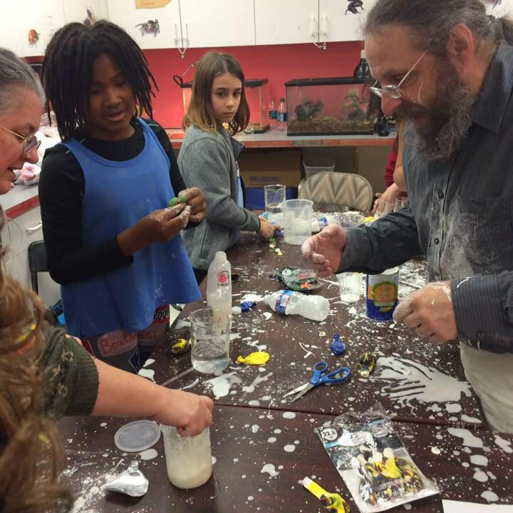 Kids in science class with teachers learning
